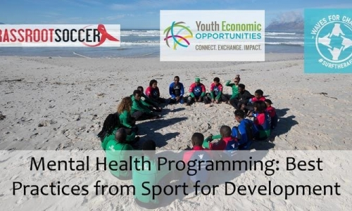 Young people wearing the surfing suit are sitting on the beach forming a circle. Banner picture for the webinar on Mental Health Programming: Best Practices from Sport for Development.