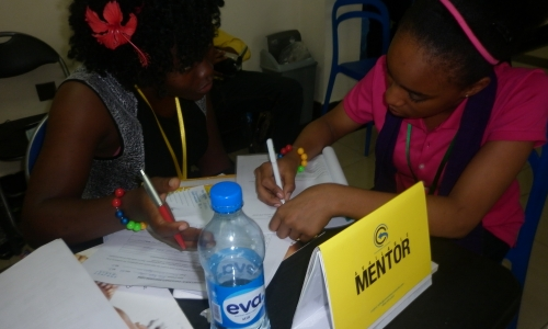 A teenage girl and a mentor during a mentoring session